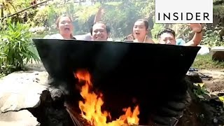Download Hot Bath Cooks Over Open Flame Video