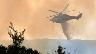 Download High temperatures, winds complicate Western wildfire fight Video