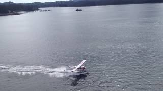 Download White and Red striped Seaplane landing on the water Flying Friday #42 Video