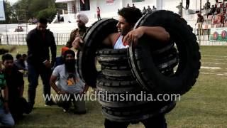 Download Wearing tyres? No, its a tyre lifting competition in India Video