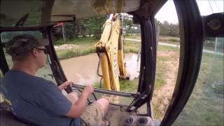 Download Backhoe Digging Mud Video