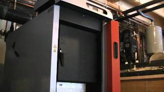 Download Firing a froling wood gasification boiler in Maine. Video