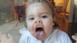 Download Cute baby girl washing windows - hilarious Video
