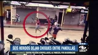 Download Con machetes, piedras y armas se enfrentaron pandillas en calle de Barraquilla Video