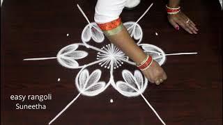 Download Bright n amazing rangoli art designs by Suneetha    easy n simple cute kolam    latest muggulu Video