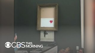 Download Banksy painting self-destructs after selling for over $1 million Video