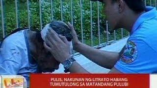 Download UB: Pulis, nakunan ng litrato habang tumutulong sa matandang pulubi sa Davao City Video