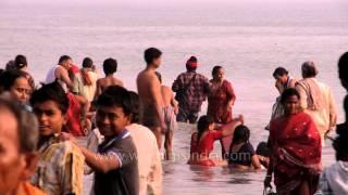 Download Devotees bathe at Ganga Sagar on the occasion of Makar Sankranti Video