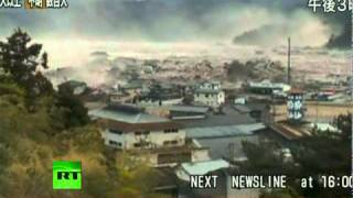 Download Japan Earthquake: Helicopter aerial view video of giant tsunami waves Video
