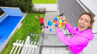 Download DROPPING 10,000 WATER BALLOONS ON STEPHEN SHARER!! (Family Vacation Prank) Video