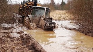 Download Valtra forestry tractor logging in wet conditions Video