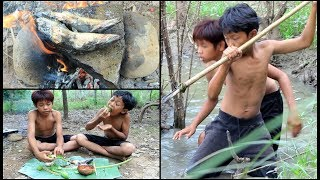 Download Primitive Technology - Find and cooking fish on a rock Video