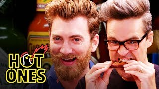 Download Rhett & Link Hiccup Uncontrollably While Eating Spicy Wings | Hot Ones Video