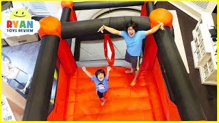 Download Giant Inflatable indoor bounce House with Slides in our living room!!! Video