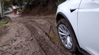Download Tesla Model X in the mud.mp4 Video