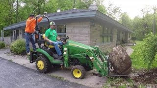 Download Compact Tractor Struggles to Move Huge Rock Video