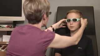 Download A child's eye examination: a visit to the optometrist video Video