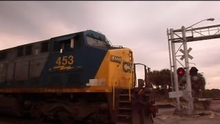 Download CSX Train Goes Through Abandoned Railroad Crossing Video