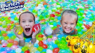 Download SWIMMING POOL FILLED WITH WATER BALLOONS! 🎈 Sisters Back To School Surprise! Video