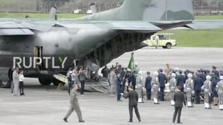 Download Colombia: Bodies of Brazilian plane crash victims journey home Video
