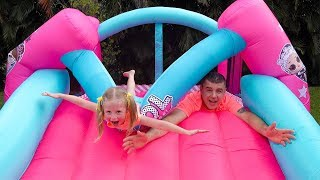 Download Stacy and dad fun playing with Inflatable water slide Video