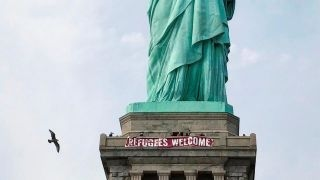 Download Banner hung on the Statute of Liberty not protected under free speech? Video