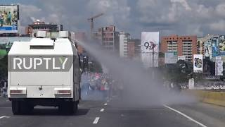 Download Venezuela: Molotov cocktails fly in Caracas as police hit protesters with water cannon Video
