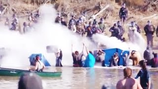 Download Police VIOLENTLY ATTACK Protesters At Standing Rock Video