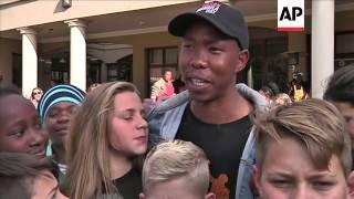 Download Grandchildren say Mandela in ″high spirits″ children eat cake, people make human chains Video