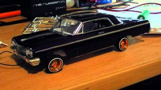 Download 1964 chevrolet impala model lowrider dancer on servos hydraulics Video