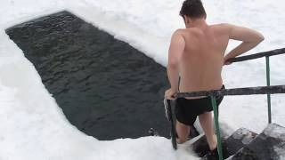 Download Americans try to swim in ice cold water in Russia Video