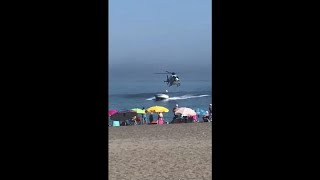 Download Watch: Police helicopter chases drug smuggler onto Spanish beach Video