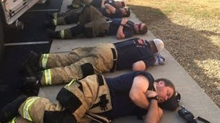 Download Firefighters Finally Rest By Sleeping On Sidewalk After Battling Wildfires Video