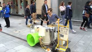 Download Guy plays drums on pots and plastic buckets Video
