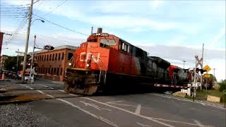 Download LONG CN TRAIN WITH MIXED FREIGHT AT MONTREAL RR CROSSING Video