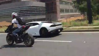 Download 2015 Lamborghini Huracan races a biker gang Video