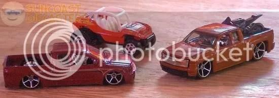 Tom buys three toy cars!