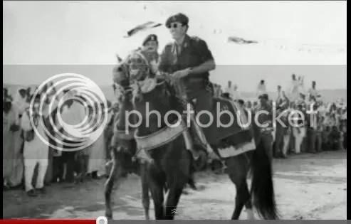 Gadhafi leads on horseback