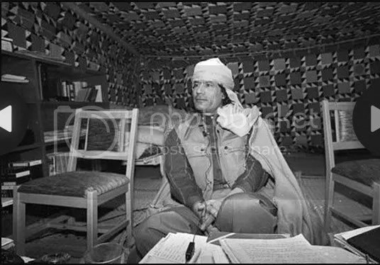 Gadhafi preparing his notes in his Tent
