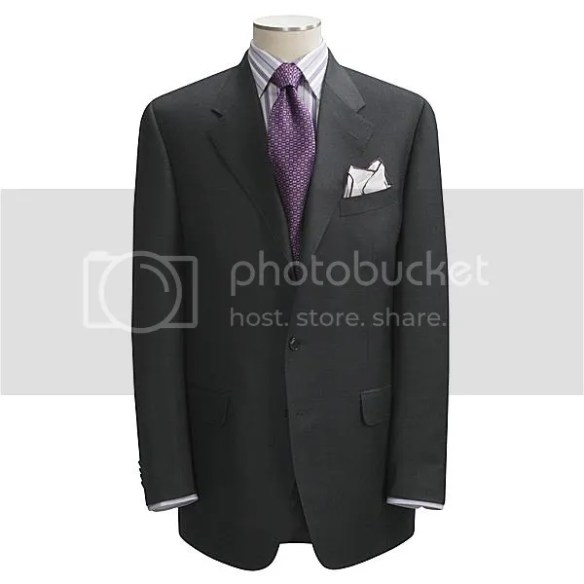 """A """"two-and-a-half"""" button lapel - it rolls above or through the top button"""