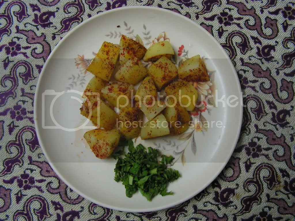 Boiled alu cubes with masala and chopped corriander leaves