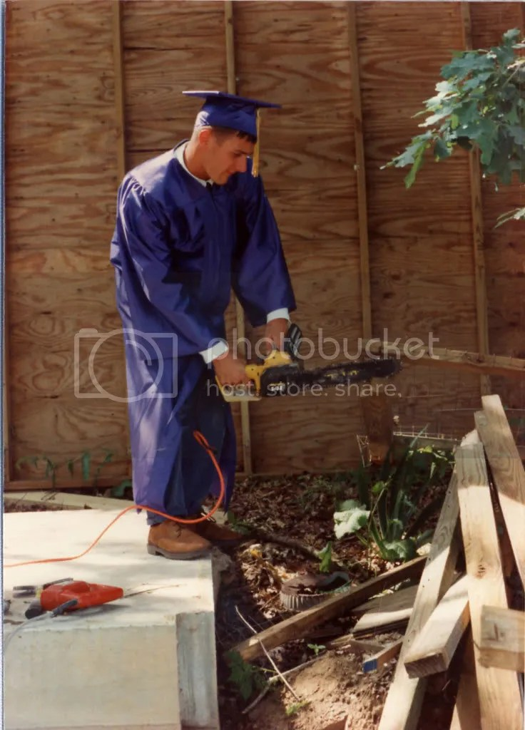 Jason cutting wood before graduation