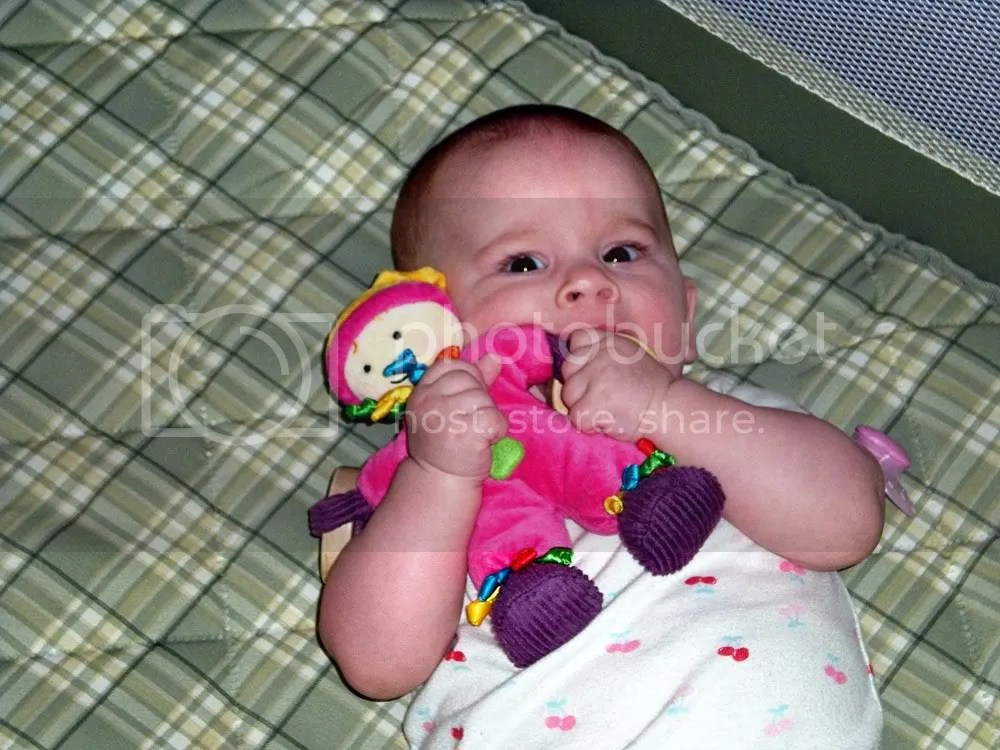 Content baby loves her Sassy doll