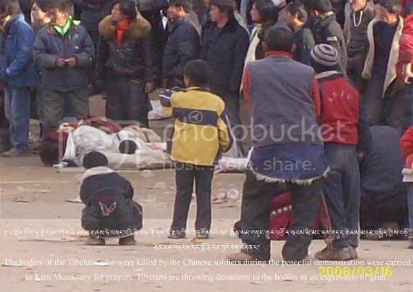 Photo of children looking on toward dead bodies of protesters in Tibet