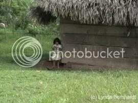 Girl by hut (c) Lynda Bernhardt