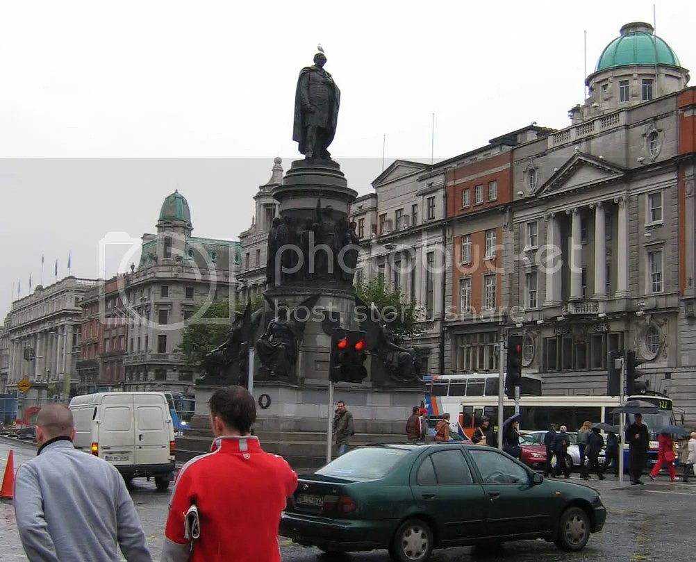Busy O'Connell street in Dublin. See the seagull perched on the statue of Daniel O'Connell?