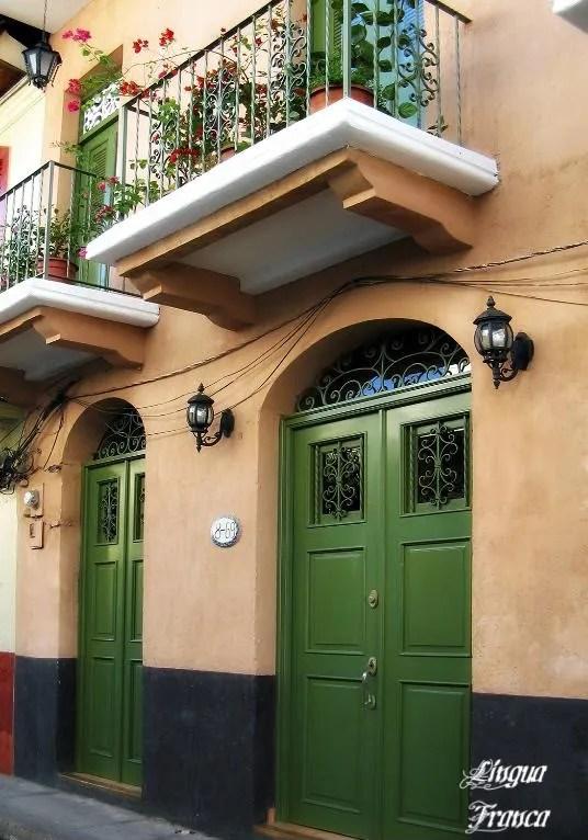Green doors of a restored house at Casco Viejo, Panama City, Panama.  (Credit:  Omar Upegui R./Michael Moore)