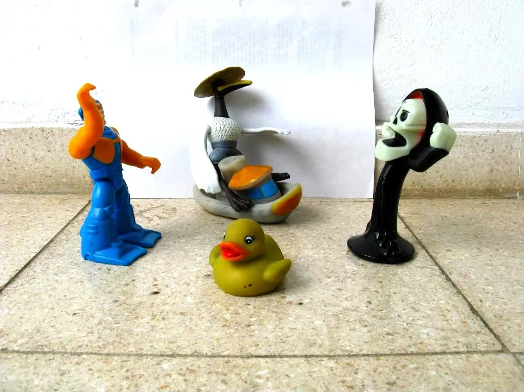 A set up of several plastic toys from Abdiels Happy Meals collection.