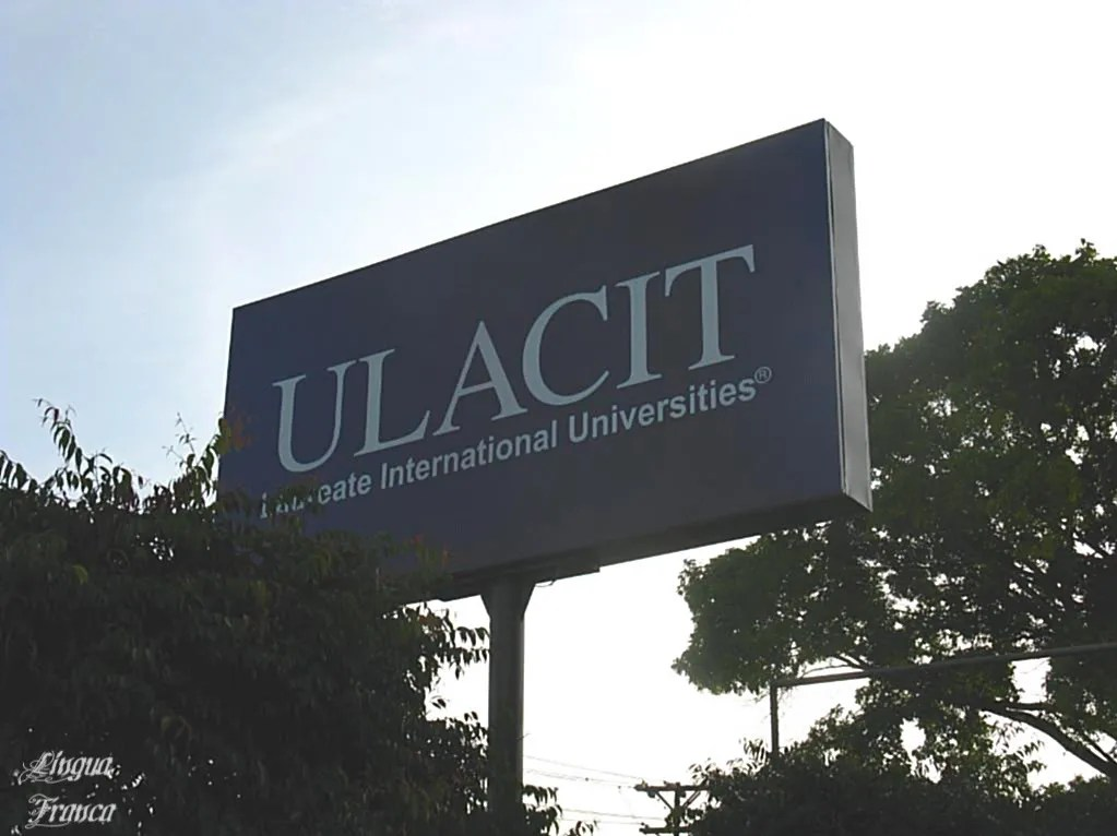 Picture of a large ULACIT blue sign outside the college premises at daybreak.  (Credit:  Omar Upegui R.)