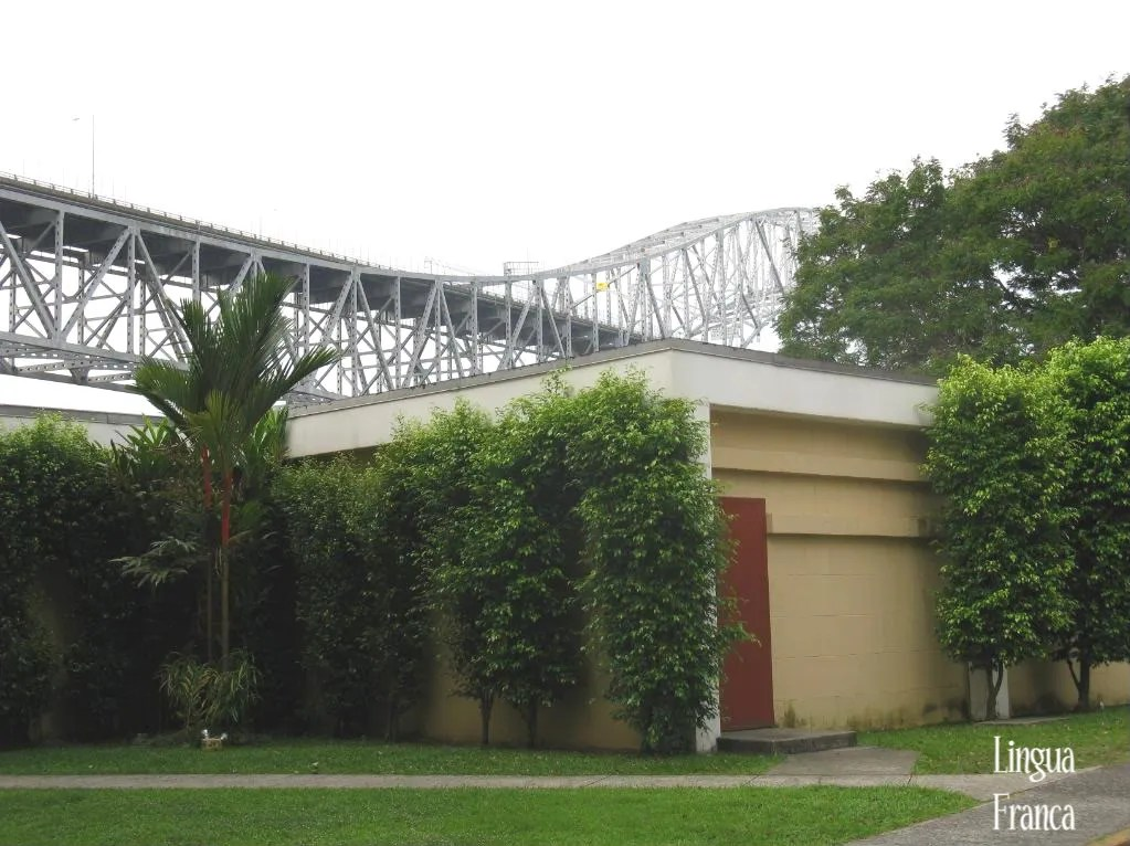Photograph taken from the campus of the former Canal Zone College.  Notice how close this building is to the Bridge of the Americas which can be clearly seen in the background.  (Credit:  Omar Upegui R.)